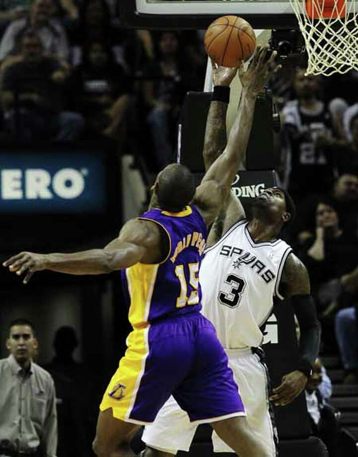 Spurs' Stephen Jackson (03) defends against Los Angeles Lakers' Metta World Peace (15) in the second half at the AT&T Center on Friday, Apr. 20, 2012. Spurs defeated the Lakers, 121-97. Kin Man Hui/Express-News. Photo: Kin Man Hui, San Antonio Express-News / ©2012 San Antonio Express-News