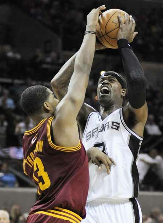 San Antonio Spurs' Stephen Jackson, right, is defended by Cleveland Cavaliers' Tristan Thompson during an NBA basketball game, Sunday, April 22, 2012, in San Antonio. The Spurs won 114-98. (AP Photo/Darren Abate) Photo: AP