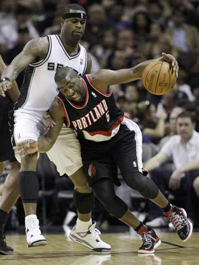 Portland Trail Blazers' Raymond Felton (5) drives into San Antonio Spurs' Stephen Jackson during the second quarter of an NBA basketball game Monday, April 23, 2012, in San Antonio. (AP Photo/Eric Gay) Photo: AP