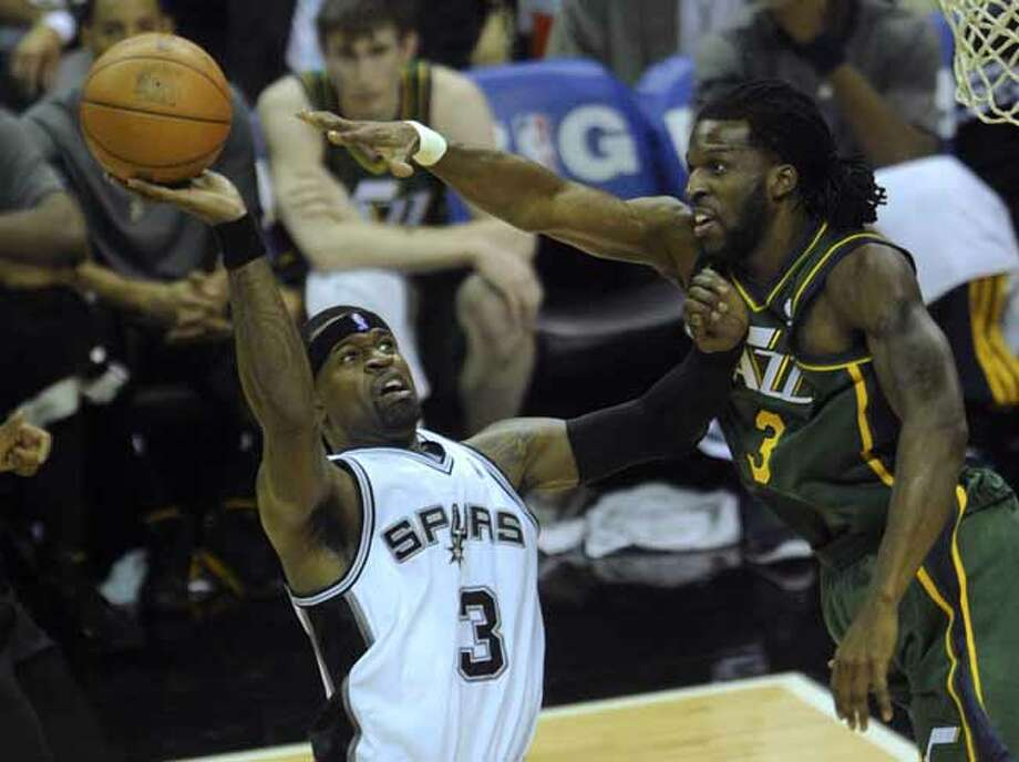 Stephen Jackson of the San Antonio Spurs, left, shoots as DeMarre Carroll of the Utah Jazz defends during NBA playoffs action at the AT&T Center on Wednesday, May 2, 2012.  Billy Calzada / San Antonio Express-News Photo: BILLY CALZADA, San Antonio Express-News / SAN ANTONIO EXPRESS-NEWS