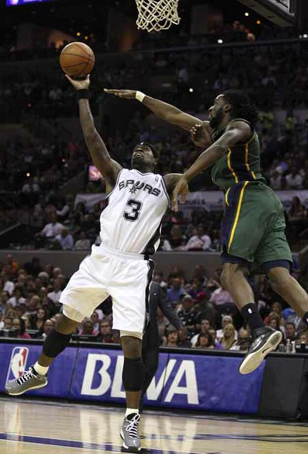 SPURS -- San Antonio Spurs Stephen Jackson keeps the ball away from Utah Jazz DeMarre Carroll during the first half of game two of the Western Conference first round at the AT&T Center, Sunday, May 2, 2012. Jerry Lara/San Antonio Express-News Photo: Jerry Lara, San Antonio Express-News / © San Antonio Express-News