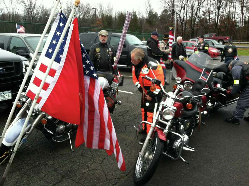Members of the Patriot Guard line up at Albany International Airport in anticipation of the arrival