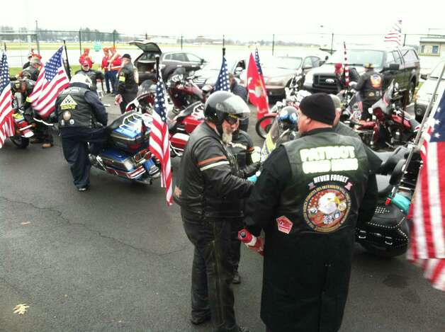 Members of the Patriot Guard line up at Albany International Airport in anticipation of the arrival of Marine Corps Lance Cpl. Anthony Denier's body. The motorcyclists are expected to escort Denier's remains to Mechanicville, where services will be held. (SKIP DICKSTEIN / TIMES UNION)