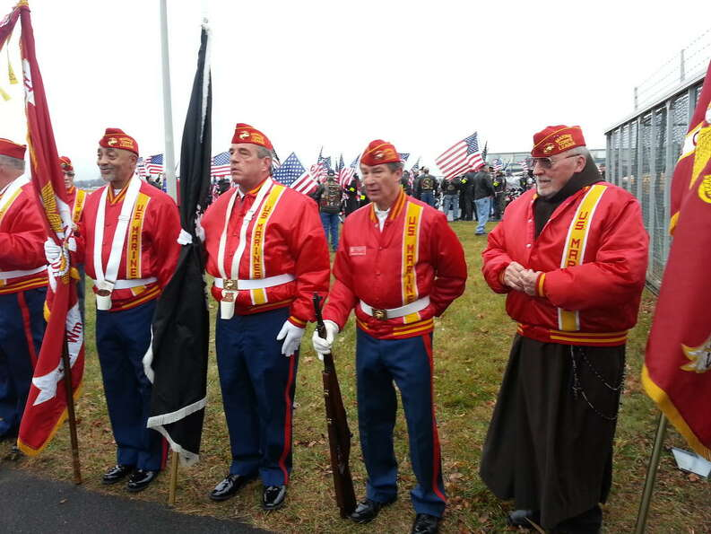 Former marines line up at Albany International Airport for the arrive of  Lance Cpl. Anthony Denier'