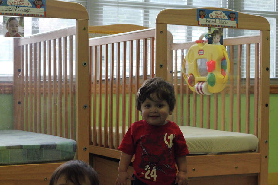 Rafael Palafos stands near one of the 14 new cribs at Blessed Sacrament Academy. Photo: Noi Mahoney/ Southside Reporter