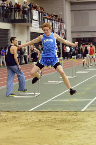 Darien's Nick Lombardo competes in the long jump during the boys FCIAC championship track meet at New Haven Athletic Center on Thursday, Feb. 3, 2011. Photo: Amy Mortensen, ST / Connecticut Post Freelance