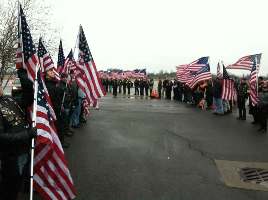 Supporters line up at Albany International Airport in anticipation of the arrival of Marine Corps Lance Cpl. Anthony Denier's body. The motorcyclists are expected to escort Denier's remains to Mechanicville, where services will be held. (SKIP DICKSTEIN / TIMES UNION)