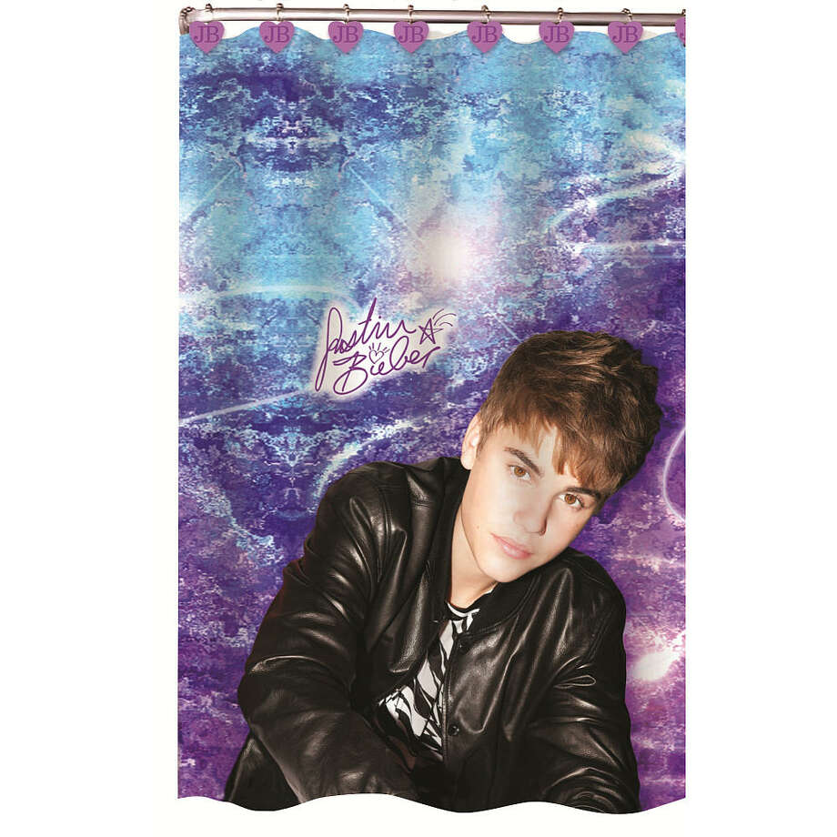 Justin Bieber shower curtain. Not weird at all having an 18-year-old Canadian pop star watch you was you soap up the armpits. Nope, not weird at all. (Toys R Us)
