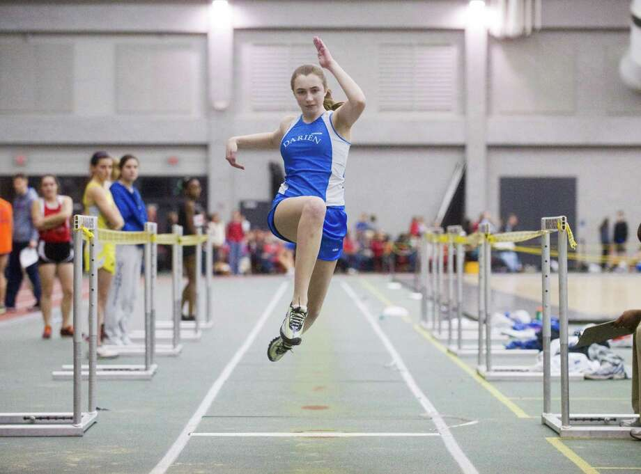 Darien's Eleanor Smith does the long jump during the FCIAC boys and girls indoor track championships at the New Haven Athletic Center in New Haven, Conn., February 2, 2012. Photo: Keelin Daly / Stamford Advocate