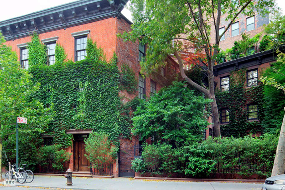 Listed for $33 million, the property comprises three townhouses surrounding a private garden (Brown, Harris & Stevens)