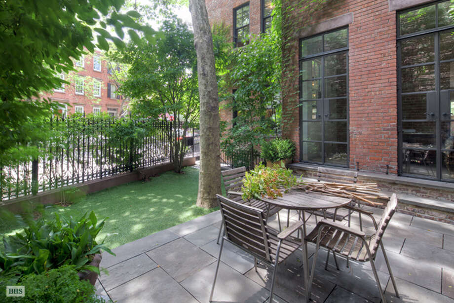 A glimpse of the outdoor area connecting the three townhouses (Brown, Harris & Stevens)