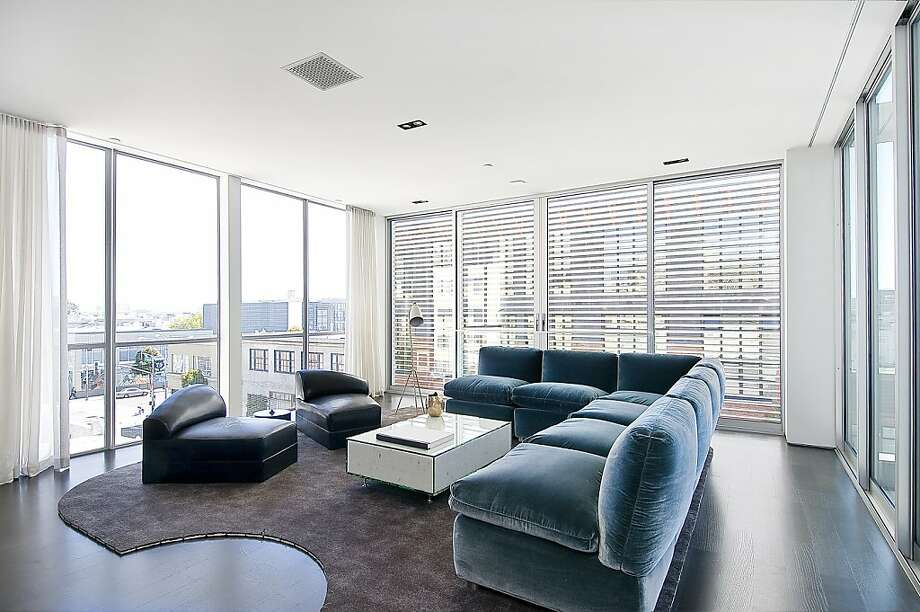 The loft features an open floor plan. Residents can control the metal louvers on the building's exterior. Photo: John Hayes, Open Home Photograph