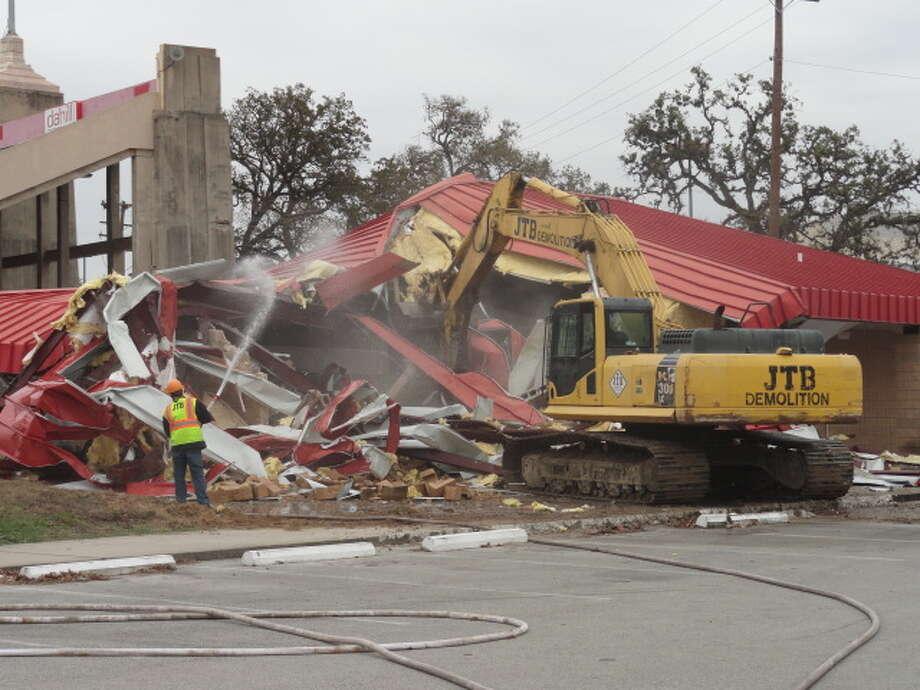 UH supporter Joe Chastang had the honor of beginning major demolition Dec. 10. (Joseph Duarte / Chronicle)