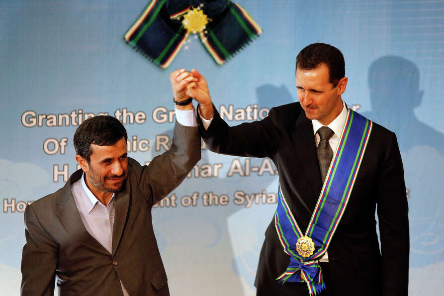 Syrian president Bashar Assad, right