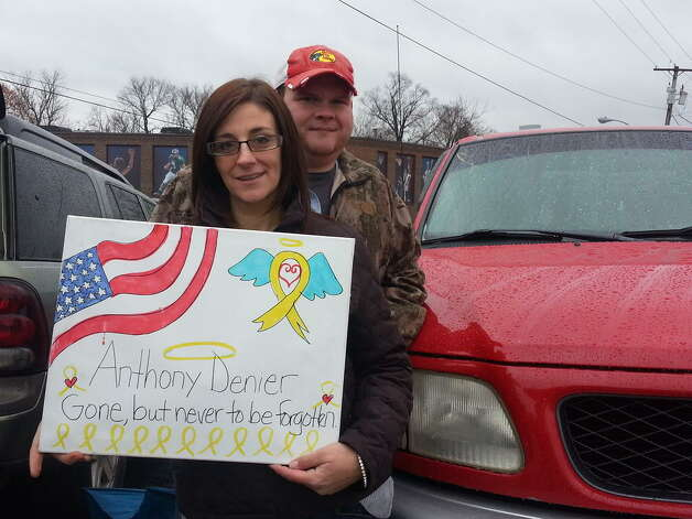 A couple that bought this pick-up truck from Marine Corps Lance Cpl. Anthony Denier prepares to salutes him as his funeral procession made its way to Mechanicville on Monday, Dec. 10, 2012. (DENNIS YUSKO / TIMES UNION)