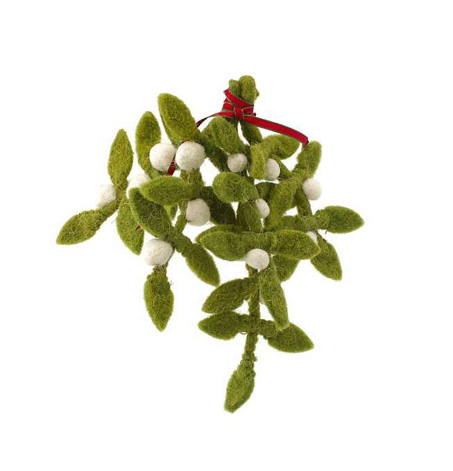 A sturdy sprig of crafty woolen mistletoe ($28.00, www.jaysonhome.com) guarantees ease of use in doorway after doorway even after a blissful kiss warms the holiday spirit, launches a thousand ships and rocks at least two worlds. Photo: Russell Yip, The Chronicle