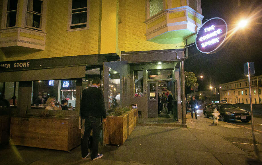 Who would have thought that the Corner Store, in an isolated building at the heavily trafficked intersection of Masonic and Geary, would become a neighborhood hangout? Photo: John Storey, Special To The Chronicle / John Storey