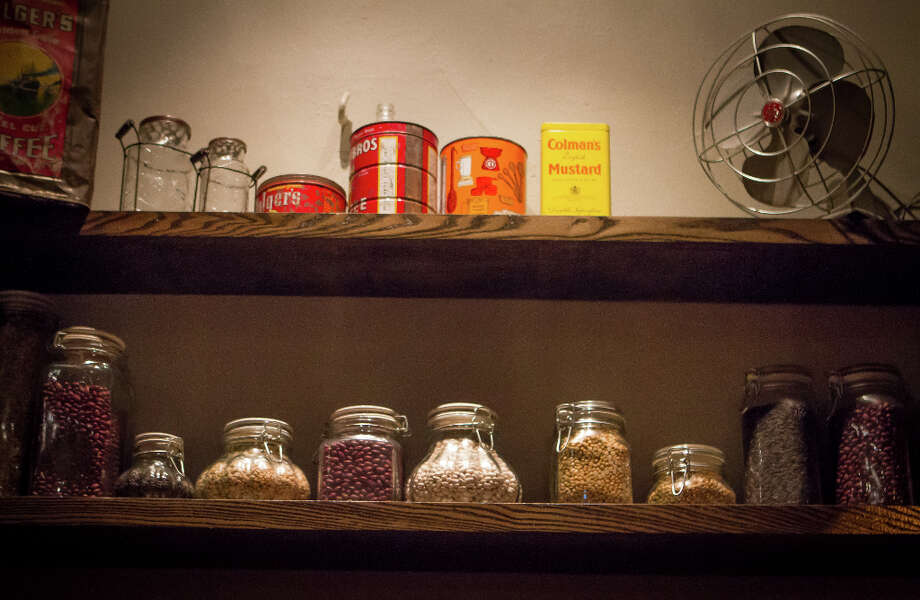 Now when you enter, you see jars of candy and rows of pickled vegetables that promote the corner-store theme. Photo: John Storey, Special To The Chronicle / John Storey
