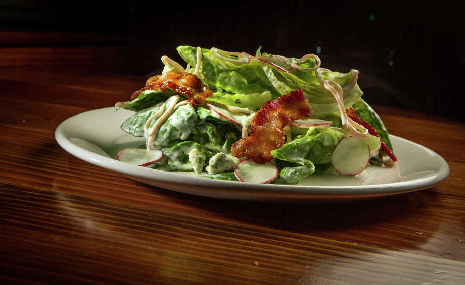 There's also a wedge ($9) updated with baby Little Gems, pickled shallots, candied bacon and a buttermilk blue cheese dressing. It's a nice rendition. Photo: John Storey, Special To The Chronicle / John Storey