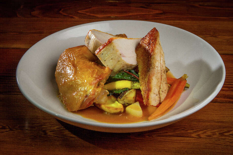 Adams generally features...only five main courses.One is roast chicken ($17), where the breast is sliced and placed on top of a confit leg and thigh, with a white wine mustard sauce, fingerling potatoes and other root vegetables. It's a sophisticated, well-executed plate, especially for the price. Photo: John Storey, Special To The Chronicle / John Storey