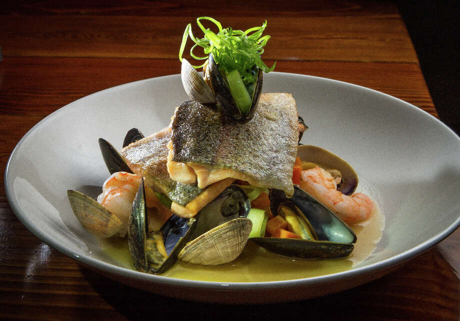 Idaho red trout ($19) is equally well conceived. The thin fillets, cut into squares and crisped on the outside, are stacked over mussels and clams in their shell, shrimp and little cubes of pumpkin, all flavored with lemongrass. I admire the way Adams weaves together the expected and unexpected in one dish. Photo: John Storey, Special To The Chronicle / John Storey