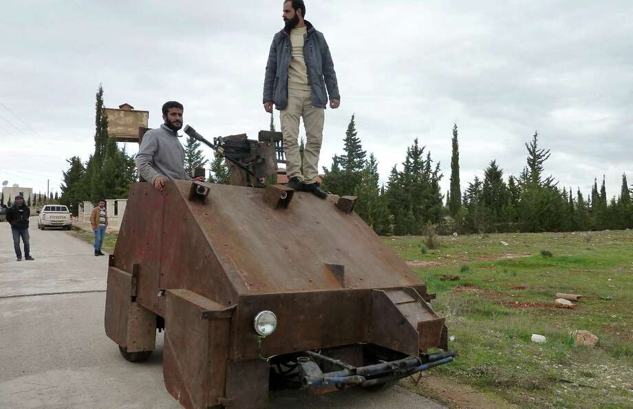 "Syrian rebels have built an armored vehicle equipped with a gun connected to what appears to be a Sony PlayStation controller. Agence France Presse reports: ""Sham II, named after ancient Syria, is built from the chassis of a car and touted by rebels as '100 percent made in Syria.'"" No word on whether there will be an Xbox version. Photo: AFP, AFP/Getty Images / 2012 AFP"