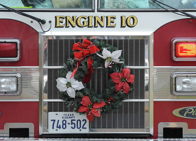 Beaumont's Engine 10 on Avenue I Monday during a Monday morning fire that began with a propane space heater. Photo taken December 10, 2012 Guiseppe Barranco/The Enterprise Photo: Guiseppe Barranco, STAFF PHOTOGRAPHER / The Beaumont Enterprise