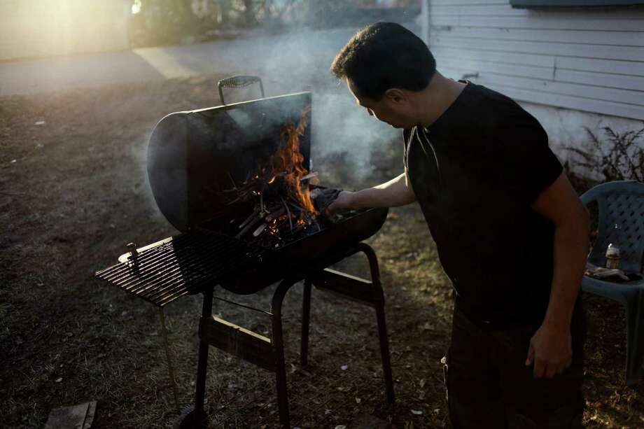 Never use a gas or charcoal grill inside your home or a closed garage. Photo: Seth Wenig, Associated Press / AP