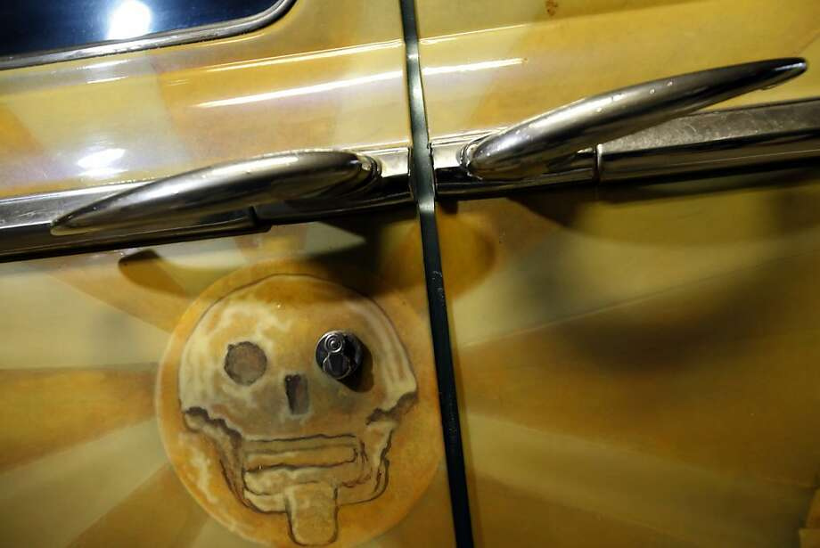 Roberto Hernandez's personal low rider car has Mayan themed art and sits in a garage in San Francisco, Calif., on Tuesday, November 27, 2012. Hernandez is an artist and has taken to training neighborhood kids how to paint low riders to keep them out of trouble in the Mission district of San Francisco, Calif. Photo: Carlos Avila Gonzalez, The Chronicle