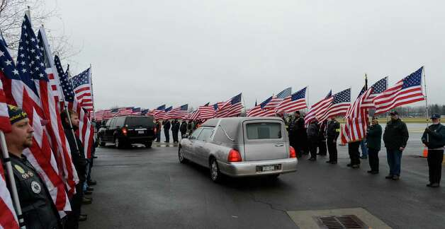 The hearse and family members of Anthony Denier arrives at the Albany International Airport in Colonie, N.Y. Dec 10, 2012.   (Skip Dickstein/Times Union) Photo: SKIP DICKSTEIN / 00020395A