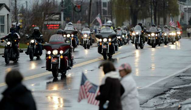 Patriot Guard motorcyclists ride up the center of Mechaniville, N.Y. Dec 10, 2012 for the funeral procession of Marine Anthony Denier.   (Skip Dickstein/Times Union) Photo: SKIP DICKSTEIN / 00020395A
