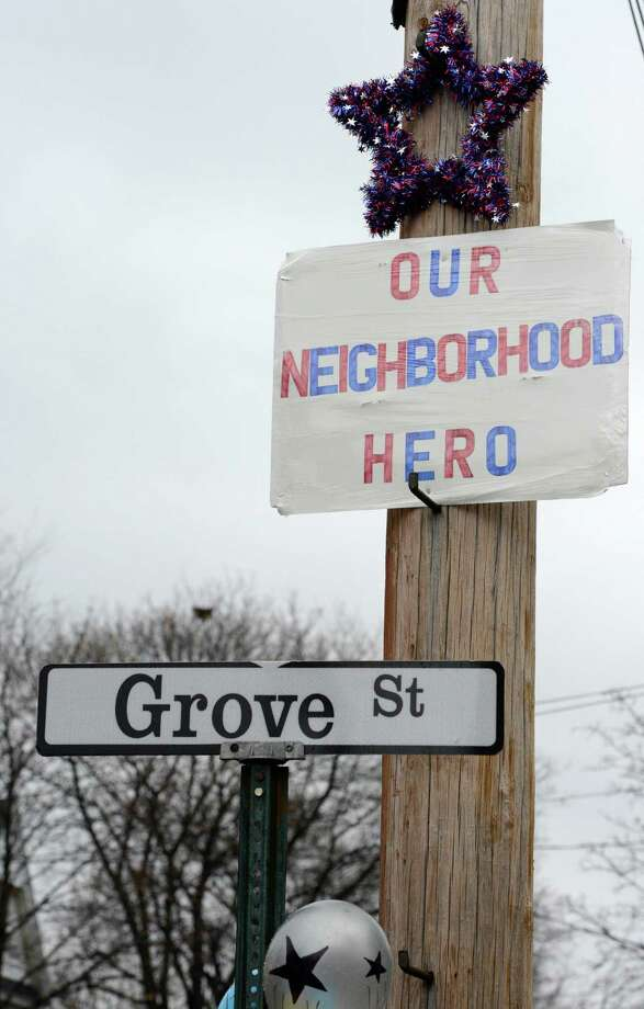 A sign on the corner of Grove Street in Mechaniville, N.Y. Dec 10, 2012 the street where fallen Marine Anthony Denier lived.    (Skip Dickstein/Times Union) Photo: SKIP DICKSTEIN / 00020395A