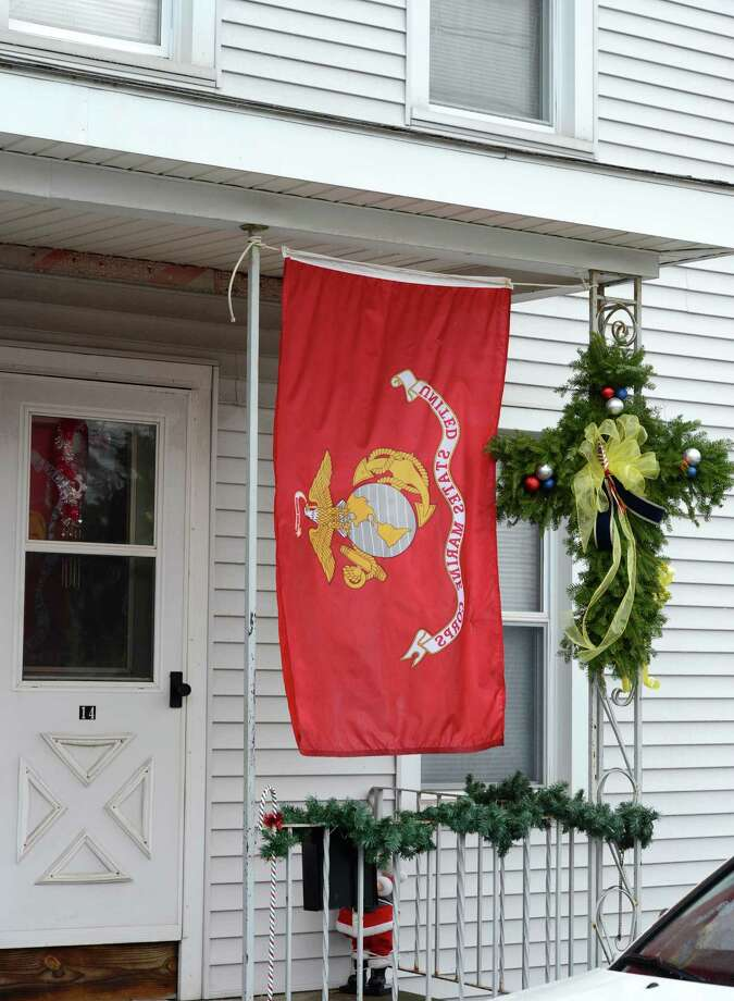A Marine flag and a evergreen cross on the front porch of 14 Grove Street in Mechanicville, N.Y. Dec 10, 2012, the home of Marine Anthony Denier who was killed in Afghanistan last week.  (Skip Dickstein/Times Union) Photo: SKIP DICKSTEIN / 00020395A