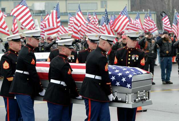 A Marine Corp honor guard carry the casket of Marine Lance Cpl. Anthony Denier of Mechanicville, N.Y., at Albany International Airport in Colonie, N.Y. Dec. 10, 2012.  Denier, who was killed by enemy fire while on patrol Dec. 2. in Marjah, Afghanistan, was taken back to Mechanicville prior to his final funeral on Tuesday. (Skip Dickstein/Times Union) Photo: SKIP DICKSTEIN / 00020395A