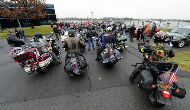 The Patriot Guard assembles at the Albany International Airport in Colonie, N.Y. Dec 10, 2012 for a funeral procession for Marine Anthony Denier who was killed in Afghanistan.   (Skip Dickstein/Times Union) Photo: SKIP DICKSTEIN / 00020395A