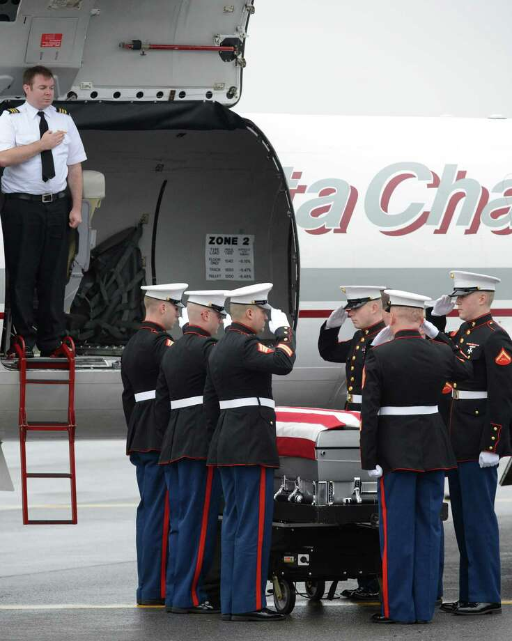 A Marine Corp honor guard prepares the coffin of Anthony Denier to be taken from the Albany International Airport in Colonie, N.Y. Dec 10, 2012 for a funeral procession to his final resting place.   (Skip Dickstein/Times Union) Photo: SKIP DICKSTEIN / 00020395A