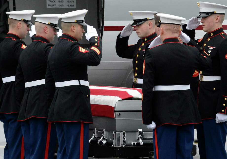 A Marine Corp honor guard salutes the coffin of Anthony Denier before it is taken from the Albany International Airport in Colonie, N.Y. Dec 10, 2012 for a funeral procession to his final resting place.   (Skip Dickstein/Times Union) Photo: SKIP DICKSTEIN / 00020395A