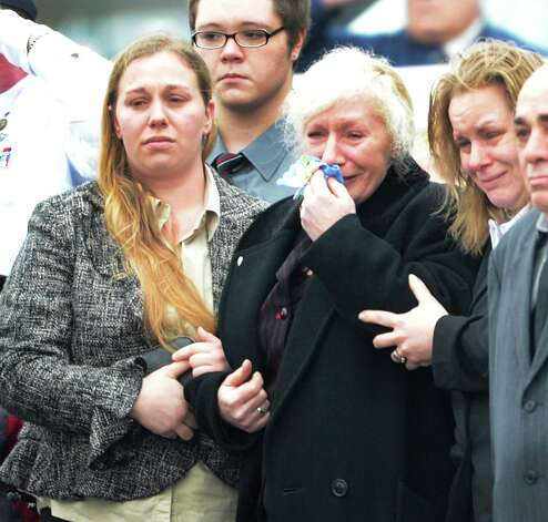 Mary Morgan, center, is comforted by her daughters as the casket of her son, Marine Lance Cpl. Anthony Denier of Mechanicville, N.Y., is taken from the Albany International Airport in Colonie, N.Y. Dec 10, 2012 for a funeral procession to Mechanicville.   (Skip Dickstein/Times Union) Photo: SKIP DICKSTEIN / 00020395A