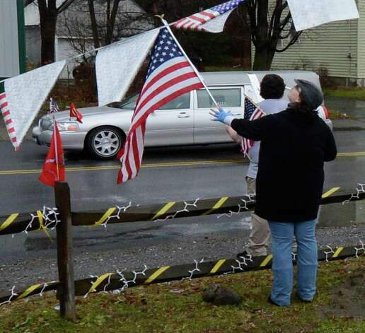 People gather on the streets of Mechaniville, N.Y. Dec 10, 2012 as the funeral procession of Marine Anthony Denier passes by.   (Skip Dickstein/Times Union) Photo: SKIP DICKSTEIN / 00020395A