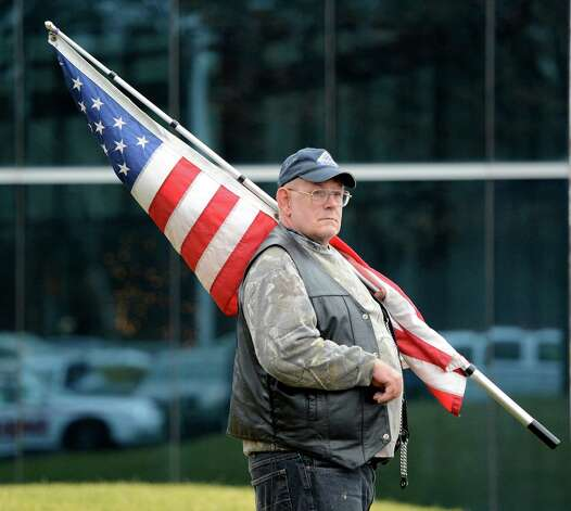 Randy Schnoop of the Southern Vermont Patriot Guard prepares for the funeral procession of Anthony Denier at the Albany International Airport in Colonie, N.Y. Dec 10, 2012.   (Skip Dickstein/Times Union) Photo: SKIP DICKSTEIN / 00020395A