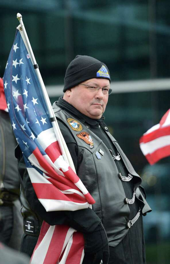 Wes Marshall of the Region 5 Patriot Guard prepares for the funeral procession of Anthony Denier at the Albany International Airport in Colonie, N.Y. Dec 10, 2012.   (Skip Dickstein/Times Union) Photo: SKIP DICKSTEIN / 00020395A
