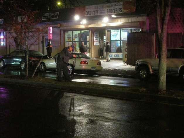 A man in an electric wheelchair was hospitalized with serious injuries after he was hit by a sport utility vehicle on Park Avenue in Bridgeport, Conn. on Friday, Dec. 7, 2012. Photo: Tom Cleary