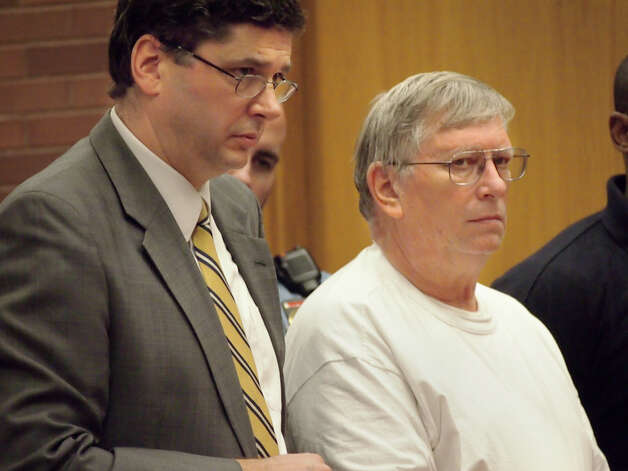 Robert Bell, 63, of New Fairfield, right, appears before Judge John Blawie in state Superior Court in Danbury on Monday, Dec. 10, 2012, for his arraignment on a charge of first-degree manslaughter. Bell is accused of shooting and killing his wife, Svetlana Bell, 47, and is being represented by Public Defender Mark Johnson, left. Photo: Danbury Patch / Pool / Danbury Patch