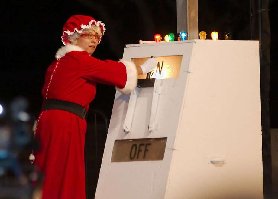 Everything's bigger in Texas: Mrs. Claus flips a switch that would feel right at home in Dr. Frankenstein's laboratory to officially light the city Christmas tree of Pasadena, Texas. Photo: Kirk Sides, Associated Press