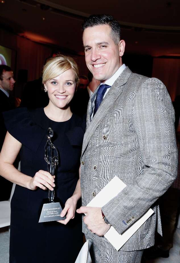 Honoree Reese Witherspoon and actor Jim Toth pose with the Grace Kelly Award during the 7th Annual March of Dimes Celebration of Babies, a Hollywood Luncheon, at the Beverly Hills Hotel on December 7, 2012 in Beverly Hills, California. Photo: Alexandra Wyman / 2012 Getty Images