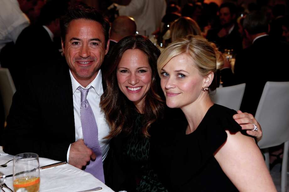 (L-R) Actor Robert Downey Jr., producer Susan Downey and honoree Reese Witherspoon attend the 7th Annual March of Dimes Celebration of Babies, a Hollywood Luncheon, at the Beverly Hills Hotel on December 7, 2012 in Beverly Hills, California. Photo: Alexandra Wyman / 2012 Getty Images