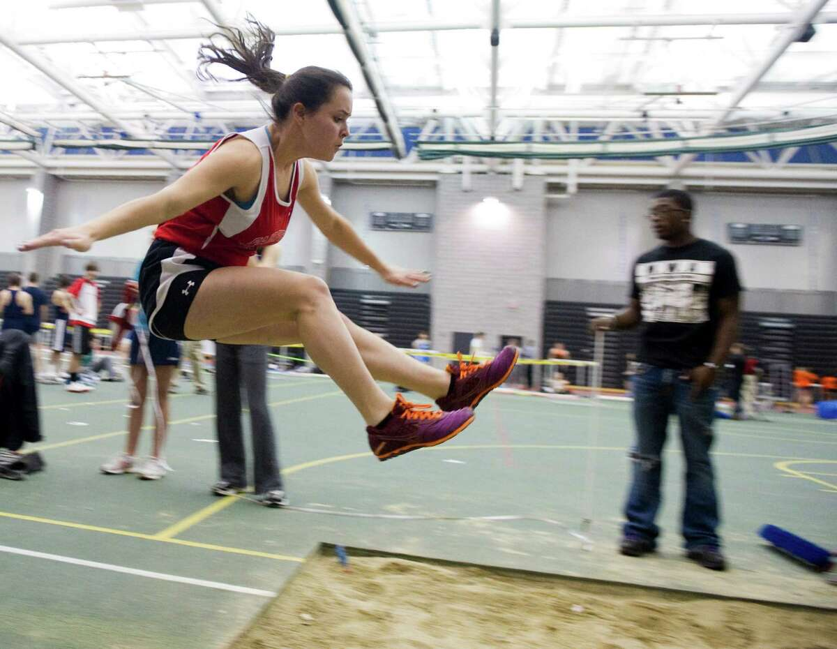 Fairfield Warde's Julia Palmieri does the long jump during the FCIAC boys and girls indoor track championships at the New Haven Athletic Center in New Haven, Conn., February 2, 2012.
