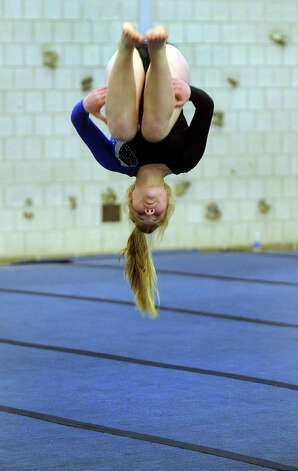Fairfield Ludlowe's Jordan Feeney competes in the floor routine, during a gymnastics meet in Weston, Conn. on Thursday January 26, 2012. Photo: Christian Abraham / Connecticut Post