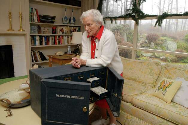Ruth Sandak at home in Stamford, Conn. on Monday December 10, 2012. She leans on a collection of photographic slides her late husband Harold took of art and architecture around the United States for a project funded by the University of Georgia and the Carnegie Foundation. Photo: Dru Nadler / Stamford Advocate Freelance