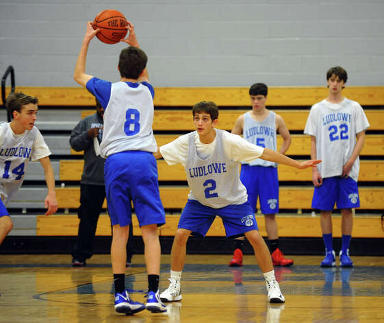 Fairfield Ludlowe's #2 Danny Santella guards, during boys basketball practice in Fairfield, Conn. on Thursday December 6, 2012. Photo: Christian Abraham / Connecticut Post